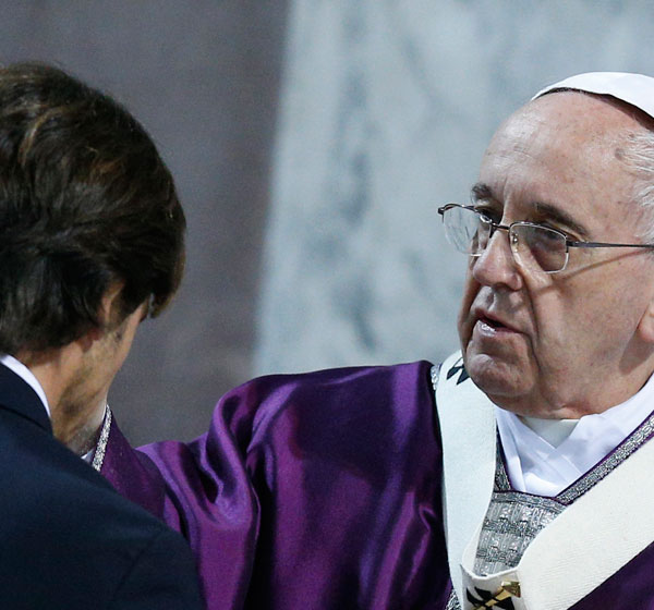 Pope Francis gives ashes during Ash Wednesday Mass in 2015 at the Basilica of Santa Sabina in Rome. (CNS/Paul Haring)