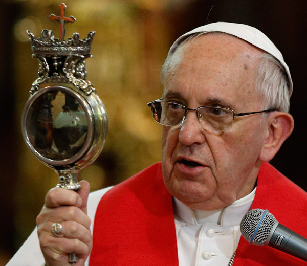 Pope Francis holds a reliquary containing what is believed to be the blood of St. Januarius as he gives a blessing during a meeting with religious at the cathedral in Naples, Italy, March 21. The dried blood of the saint is said to liquefy several times a year. After the pope handled the relic, the blood apparently liquefied. (CNS/Paul Haring)