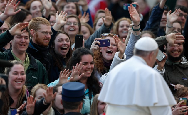 Students from the Austrian program of Franciscan University of Steubenville react as Pope Francis arrives to lead his general audience in St. Peter's Square at the Vatican March 4. (CNS/Paul Haring)