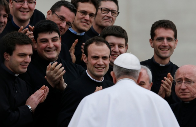 Pope Francis greets clergy during a general audience. (CNS/Paul Haring)