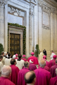 Pope Francis stands in front of the Holy Door prior to first vespers of Divine Mercy Sunday in St. Peter's Basilica at the Vatican April 11. (CNS/pool via Reuters)
