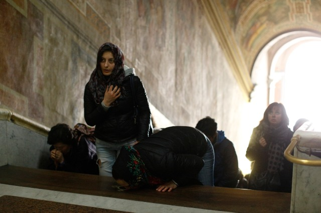 People pray on the Holy Stairs at the Pontifical Sanctuary of the Holy Stairs in Rome. (CNS/Paul Haring)