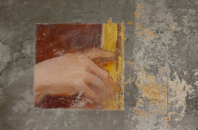 A hand is seen in a recently found section of a fresco at the Sanctuary of the Holy Stairs in Rome. The discovery of the hidden painting was made when masons were installing electrical conduit. The Sanctuary of the Holy Stairs is being completely restored in a 15-year-long project. (CNS/Paul Haring)