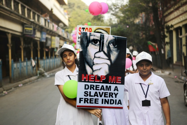 Students from the Archdiocese of Calcutta take part in a walk for peace against human trafficking in 2015 in Kolkatta, India. (CNS/EPA)