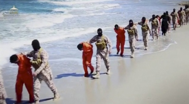 Islamic State militants lead what are said to be Ethiopian Christians along a beach in Libya in this still image from an undated video made available on a social media website in 2015. (CNS/via Reuters TV)