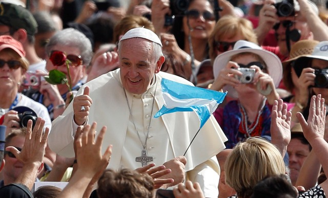 Argentina's flag is seen as Pope Francis arrives to lead his general audience. (CNS/Paul Haring)