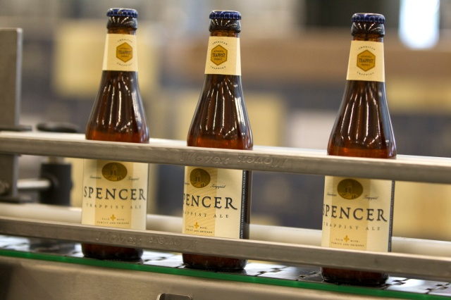 Bottles of beer brewed by Trappist monks sit on a conveyer belt at the new state-of-the-art brewery on the grounds of St. Joseph's Abbey in Spencer, Mass. The monks began operating the first American Trappist brewery about a year ago. (CNS/Chaz Muth)