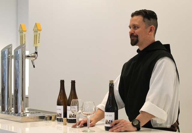 Trappist Brother Jonah Pociadlo prepares to pour Spencer Trappist Ale for an April 29 taste testing for fellow monks and lay workers at the new state-of-the-art brewery on the grounds of St. Joseph's Abbey in Spencer, Mass. (CNS/Chaz Muth)