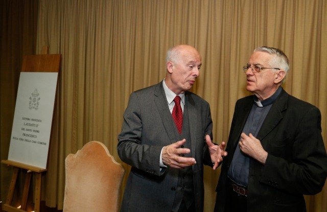 Hans Joachim Schellnhuber, founding director of the Potsdam Institute for Climate Impact Research, and Jesuit Father Federico Lombardi, the Vatican spokesman, talk before a news conference to present Pope Francis' encyclical on the environment at the Vatican June 18. (CNS/Paul Haring)