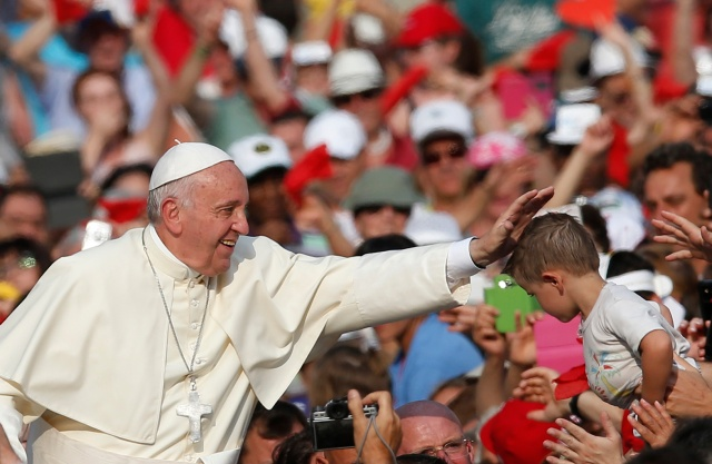 Pope Francis arrives to greet pilgrims in St. Peter's Square at the Vatican last year. (CNS/Paul Haring)