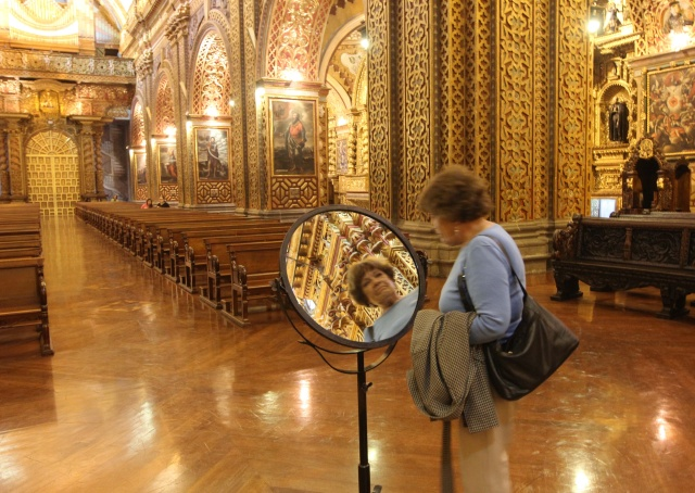 A visitor uses a mirror to take a closer look at the ornate architectural details of Quito's Iglesia de la Compania July 3. Pope Francis will visit the church in Ecuador on Tuesday. (CNS/Barbara Fraser)