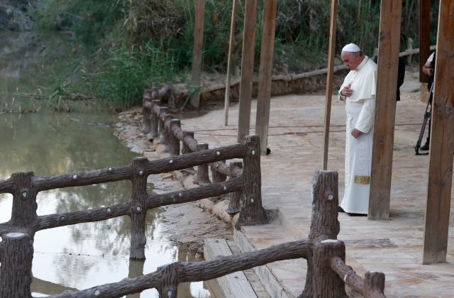 Pope Francis makes the Sign of the Cross in 2014 after praying at Bethany Beyond the Jordan, which UNESCO just declared a World Heritage site and the location of Jesus' baptism. (CNS/Paul Haring)