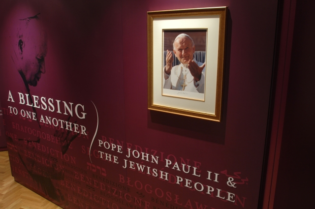 """The opening panel of the exhibit, """"A Blessing to One Another: Pope John Paul II and the Jewish People,"""" is seen  in the Vatican's Braccio di Carlo Magno hall. The exhibit runs July 29-Sept. 16. (CNS/courtesy of Blessing Exhibit)"""