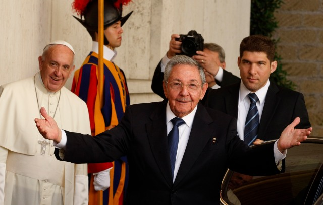 Cuban President Raul Castro gestures toward the media as he leaves a private meeting with Pope Francis at the Vatican May 10. (CNS/Paul Haring)