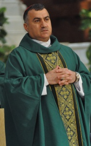 Chaldean Catholic Archbishop Bashar Warda of Irbil, Iraq, concelebrates an Aug. 23 Mass at SS. Peter and Paul Cathedral in Indianapolis. The archbishop visited several U.S. cities and discussed his experience with the flood of Christian refugees to Irbil following the Islamic State's capture of Mosul and the Ninevah Plain . (CNS/Sean Gallagher, The Criterion)