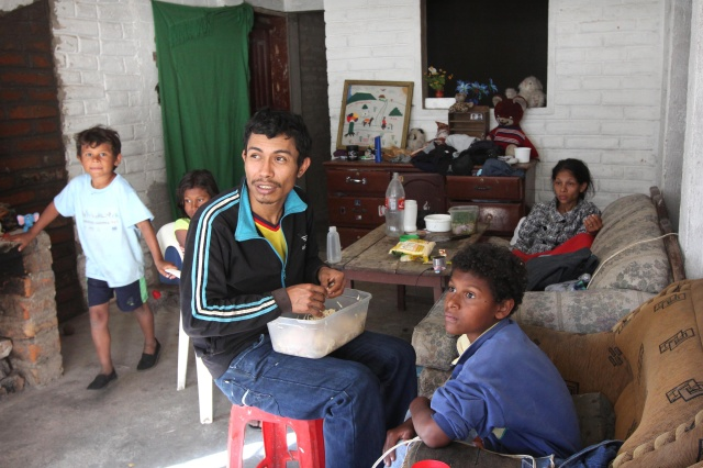 A refugee family which fled violence in Colombia is seen in its new home in 2015 in Quito, Ecuador. (CNS/Barbara Fraser)