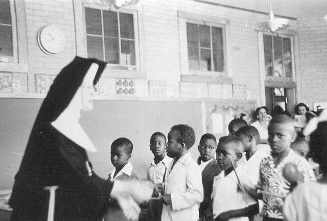 A Sister of St. Joseph of the Third Order of St. Francis is shown teaching a class May 27, 1953, at St. Francis School in Greenwood, Mississippi. The school endured attacks by segregationists in the 1950s and 1960s because of its commitment to the African-American community. (CNS/Bishop Oliver Gerow, courtesy Diocese of Jackson Archives)