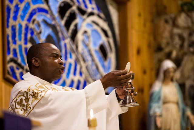 Father Jean Paulin Lockulu celebrates Mass at St. John by the Sea Church in Klawock on Prince of Wales Island in southeastern Alaska. (CNS/Nancy Wiechec)