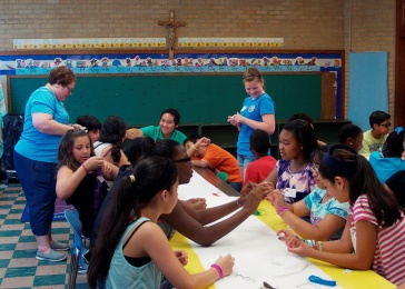 Volunteers from Manitowoc, Wisconsin, including members of that town's St. Francis of Assisi Catholic Church, help run a summer camp for the children of Greenwood, Mississippi, at St. Francis of Assisi Church. (CNS/Maureen Smith, Mississippi Catholic)