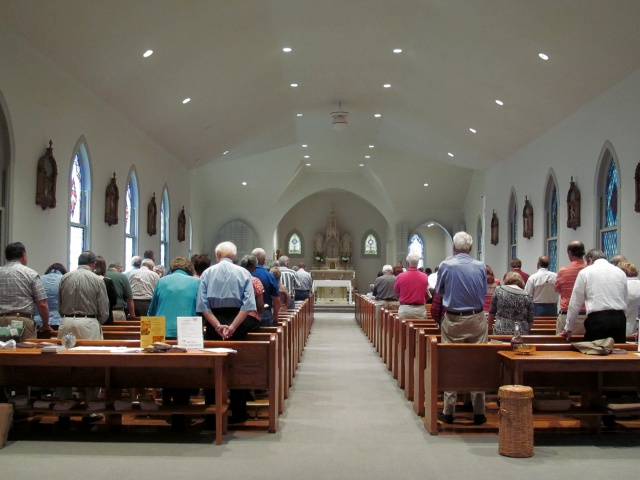 Mass is celebrated at Immaculate Heart of Mary Church in Greenwood, Mississippi, the older of two Catholic parishes in the small Mississippi Delta city that share a pastor and some functions. (CNS/Patricia Zapor)