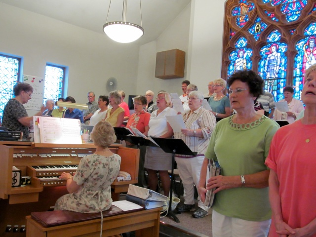One of several choirs that rotate among three worship sites of St. Francis of Assisi Parish in Manitowoc, Wisconsin, sings during Sunday Mass. (CNS/Patricia Zapor)