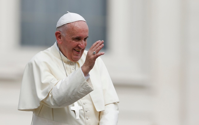 Pope Francis waves as he leaves his general audience in St. Peter's Square at the Vatican Sept. 16. (CNS/Paul Haring)