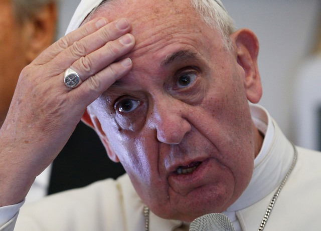 Pope Francis speaks to media aboard his flight from Cuba to the United States Sept. 22. (CNS/Paul Haring)