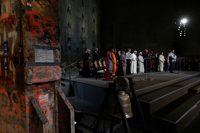 Pope Francis joins representatives of religious communities for meditations on peace in Foundation Hall at the ground zero 9/11 Memorial and Museum in New York Sept. 25. (CNS/Paul Haring)