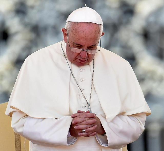 Pope Francis, seen praying during his weekly audience in St. Peter's Square at the Vatican Aug. 26, has issued a letter offering a series of instances in which absolution can be granted during the Year of Mercy. (CNS/Ettore Ferrari, EPA)