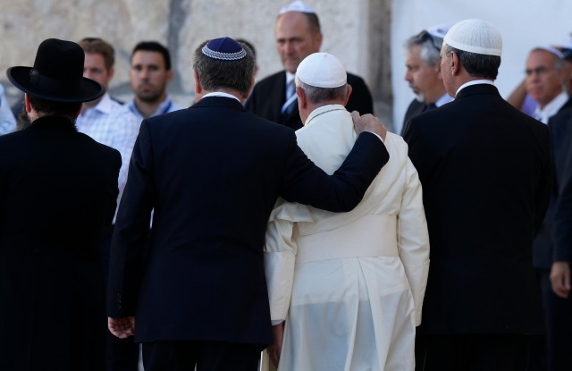 In a historic interreligious meeting, Pope Francis is embraced by Argentine Rabbi Abraham Skorka as he leaves after praying at the Western Wall in Jerusalem last year. On the right is Omar Abboud, Muslim leader from Argentina. (CNS/Paul Haring)