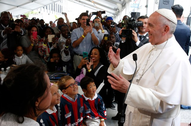 Pope Francis meets people involved with St. Maria's Meals Program of Catholic Charities in Washington Sept. 24. (CNS/Paul Haring)