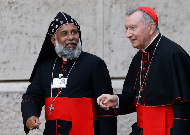 Cardinals Baselios Cleemis Thottunkal of Trivandrum, India, major archbishop of the Syro-Malankara Catholic Church and Pietro Parolin, Vatican secretary of state, arrive for a session of the Synod of Bishops on the family. (CNS/Paul Haring)