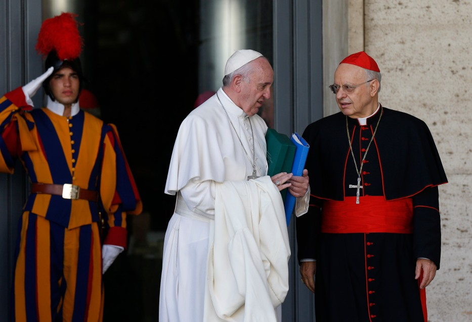 Pope Francis talks with Cardinal Lorenzo Baldisseri, general secretary of the Synod of Bishops, as he leaves a session of the synod at the Vatican Oct. 24. (CNS/Paul Haring)