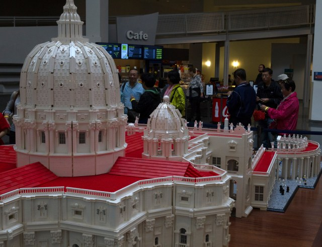 Visitors to the Franklin Institute museum in Philadelphia take a look at a Lego rendition of the Vatican's St. Peter's Basilica, crafted by Father Bob Simon, pastor of St. Catherine of Siena Parish in Moscow, Pa. (CNS/Chaz Muth)