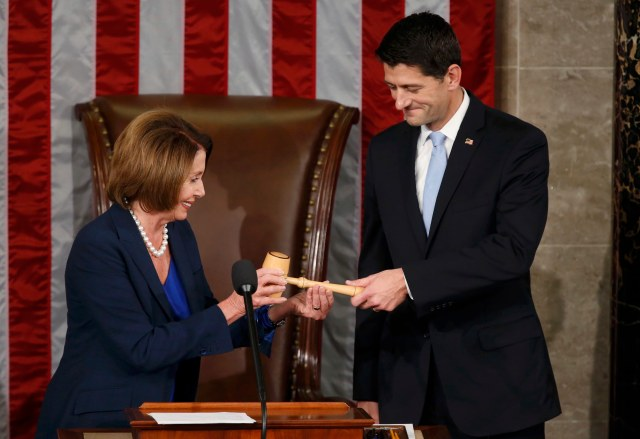 Former U.S. House Speaker and current Minority Leader Nancy Pelosi, D-Calif., hands incoming House Speaker Paul Ryan, R-Wis., the gavel after his election on Capitol Hill in Washington Oct. 29. (CNS/Reuters)