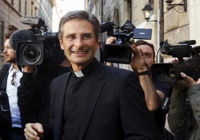 Msgr. Krzystof Charamsa leaves the news conference in Rome where he announced he was gay and has a partner. He had worked at the Congregation for the Doctrine of the Faith since 2003. (CNS/REUTERS, Alessandro Bianchi)