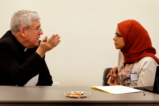 Father John Crossin, executive director of the Secretariat for Ecumenical and Interreligious Affairs of the U.S. Conference of Catholic Bishops, talks with a member of Council of Islamic Organizations of Greater Chicago in 2012. (CNS photo/Karen Callaway, Catholic New World)
