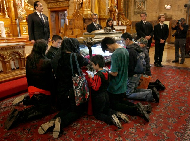 Worshippers venerate the relics of St. Maria Goretti at St. John Cantius Church in Chicago Oct. 12. (CNS photo/Karen Callaway, Catholic New World)