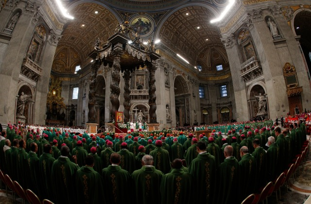 The 270 cardinals, priests and priests who are voting members of the Synod of Bishops on the family concelebrated the synod's opening Mass Oct. 4 with Pope Francis in St. Peter's Basilica. (CNS/Paul Haring)