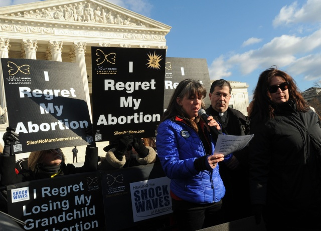 Protesters gather during a rally outside the U.S. Supreme Court during the March for Life in Washington Jan. 22. (CNS/Leslie E. Kossoff)
