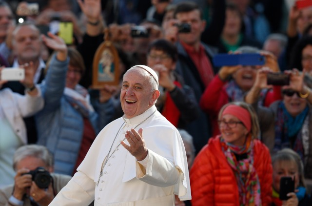 Pope Francis greets the crowd during his general audience in St. Peter's Square at the Vatican Nov. 4. (CNS/Paul Haring)