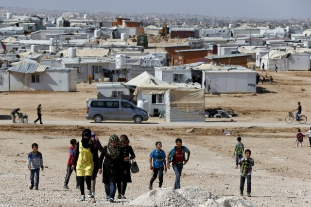 Syrian refugees walk at Zaatari refugee camp in the Jordanian city of Mafraq, near the border with Syria, Nov. 1. (CNS/Reuters)