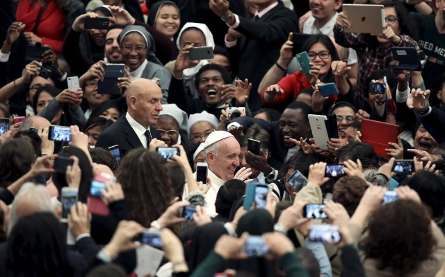 People take pictures as Pope Francis arrives to lead a Nov. 21 audience for participants in a world congress sponsored by the Congregation for Catholic Education. (CNS/Reuters)