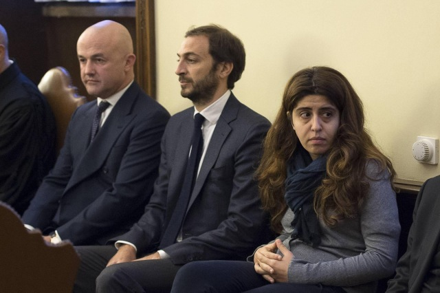 Italian journalists and authors Gianluigi Nuzzi and Emiliano Fittipaldi and Italian laywoman Francesca Chaouqui, a member of the former Pontifical Commission for Reference on the Organization of the Economic-Administrative Structure of the Holy See, are seen in a courtroom Nov. 24, the first day of the 'VatiLeaks' case at the Vatican. (CNS/L'Osservatore Romano via Reuters)