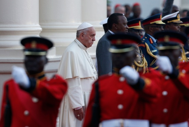Pope Francis and Kenyan President Uhuru Kenyatta review an honor guard at the State House in Nairobi Nov. 25. The pope was beginning a six-day visit to Africa with stops also in Uganda and the Central African Republic. (CNS/Paul Haring)