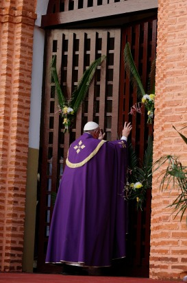 Pope Francis opens the Holy Door at the start of a Mass with priests, religious, catechists and youths at the cathedral in Bangui, Central African Republic, Nov. 29. (CNS/Paul Haring)