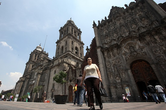People walk outside the Metropolitan Cathedral in 2013 in Mexico City. Mexican Foreign Minister Claudia Ruiz Massieu has confirmed that Pope Francis will visit the capital, along with the states of Chihuahua and Chiapas, on the northern and southern borders respectively, and Michoacan in western Mexico. (CNS photo/Alex Cruz, EPA)
