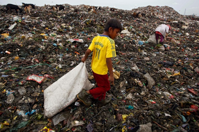 A boy collects recyclable materials at a dumpsite in Medan, Indonesia, Nov. 30. The U.N. climate change conference, known as the COP21 summit, runs from Nov. 30-Dec. 11 near Paris. (CNS/Reuters)