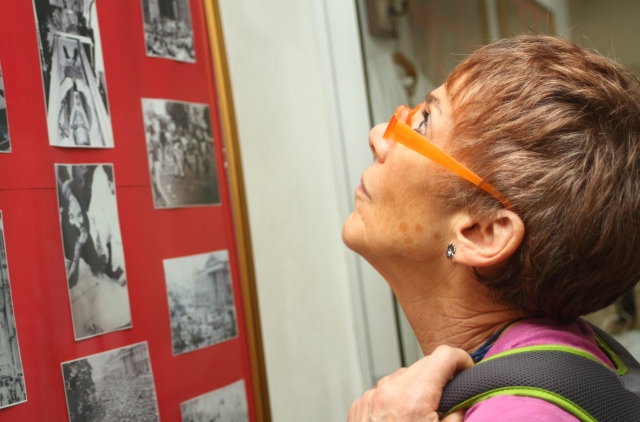 An American delegate looks at photos Nov. 30 in a museum dedicated to the late Salvadoran Archbishop Oscar Romero in San Salvador. U.S. religious and activists visited El Salvador to attend a memorial service for the 35th anniversary of the killings of four churchwomen, Dec. 2, 1980. (CNS/Edgardo Ayala)