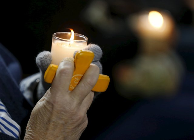 A candle and a cross are held during a vigil in San Bernardino, Calif., Dec. 3 for the victims of the mass shooting the previous day at the Inland Regional Center. (CNS/Reuters)